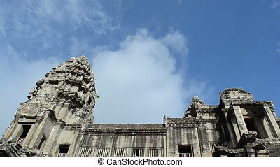 clouds flying pass the angkor wat building