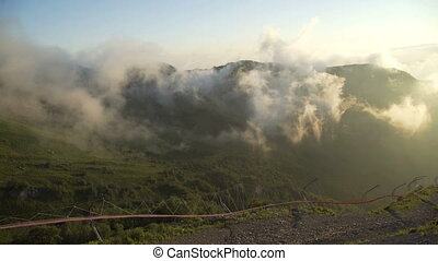 Clouds forming on side of mountain peakst. Golden Hour...