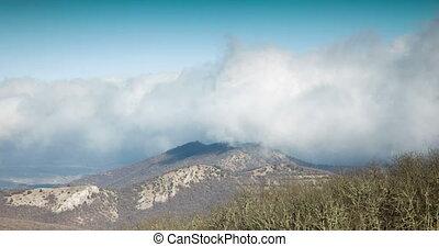 clouds hide the mountain peak