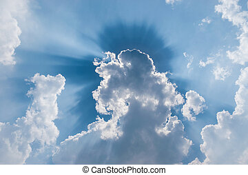 clouds in blue sky with sunrays