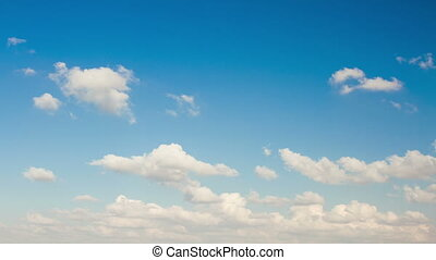 Clouds in the blue sky. - Beautiful white clouds on a blue...