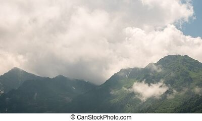 Clouds in the mountains. Zoom. Rosa Khutor, Sochi, Russia
