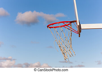 Clouds in the sky fly into a basketball hoop