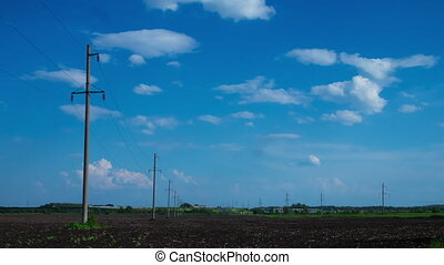 clouds in the sky, rural field plowed earth electricity poles power time period nature tree agriculture clouds sun wind electric wires mains summer spring grass ecology energy energy infrastructure platform 6