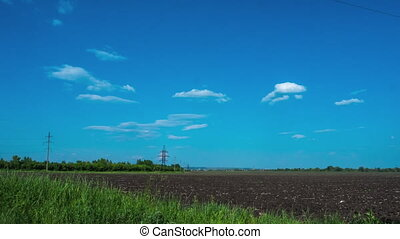 clouds in the sky, rural field plowed earth electricity poles power time period nature tree agriculture clouds sun wind electric wires mains summer spring grass ecology energy energy infrastructure platform 1