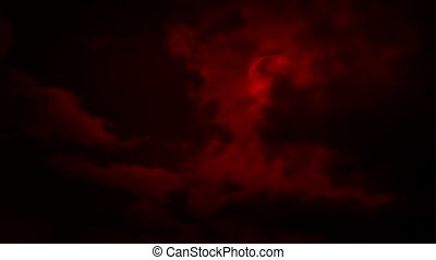 Clouds Move Over A Red Moon