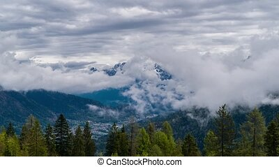 Clouds move over the Dolomites
