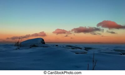 clouds move over the snow-covered field timelapse video