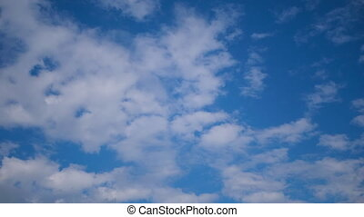 Clouds Move Smoothly in the Blue Sky. Timelapse. Sunny blue...
