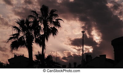 Clouds moving at sunset silhouette