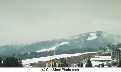 Clouds moving over the mountains. Ski resort. Time Lapse 4K...