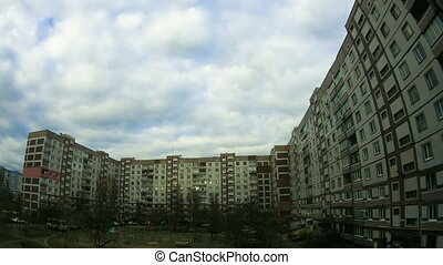 Clouds Moving over the Multistorey Buildings Time Lapse