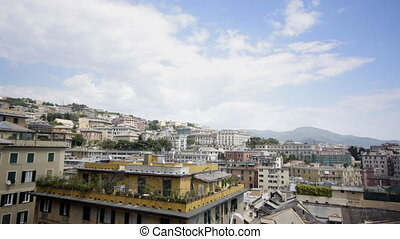 clouds moving over the skyline of genova, italy
