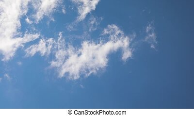 Clouds moving real time - Clouds moving in the blue sky,...