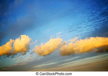 clouds on dark skies
