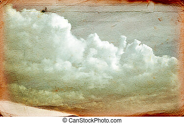 Clouds on old grunge paper