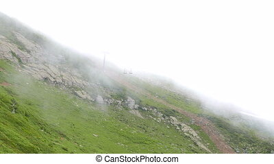 Clouds on the slope. Cableway. Ridge Aibga. Sochi, Russia....