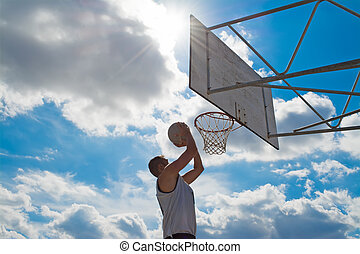 clouds over a basketball player - basketball player shooting...
