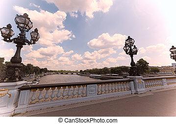 Clouds over Alexander III bridge in Paris