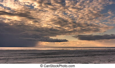 Clouds over Beach Landscape at Sunset.