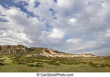 clouds over Colorado ranch
