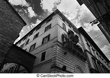 Clouds over elegant buildings in Siena