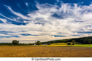Clouds over farm fields and distant hills in rural York County, Pennsylvania.