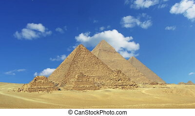 Clouds over great pyramids in Egypt - zoom in timelapse