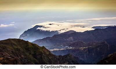 Clouds over mountains from Pico do Areiro, volcanic island...