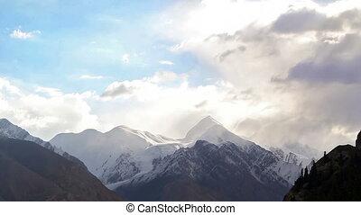 Clouds over peak Battleship (Bronenosec). Kirgystan, central...