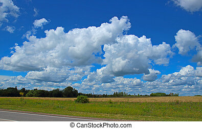 Clouds over summer field