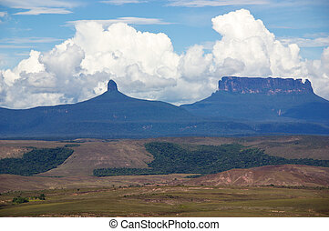 Clouds over tepui - White clouds in blue sky over table-top ...
