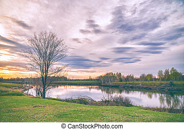 Clouds over the autumn lake in evening