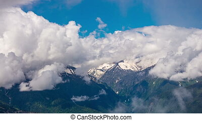 Clouds over the Caucasus mountains on a sunny day, timelapse