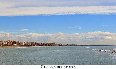 Clouds over the coast. Ostia, Rome, Italy. Time Lapse