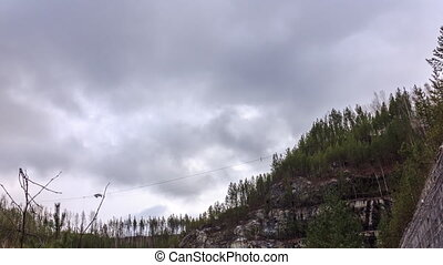 Clouds over the forest. Zoom. Russia. HDR, Time Lapse
