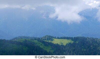 Clouds over the hills. Ridge Aibga. Sochi, Russia. UltraHD...