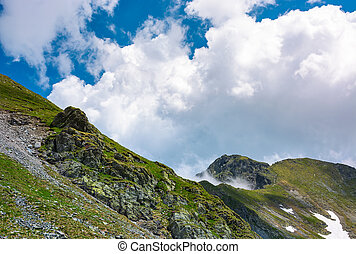 clouds over the mountain ridge with rocky cliffs. beautiful...