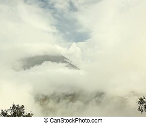 Clouds over the summit of Tungurahu - In the Ecuadorian...
