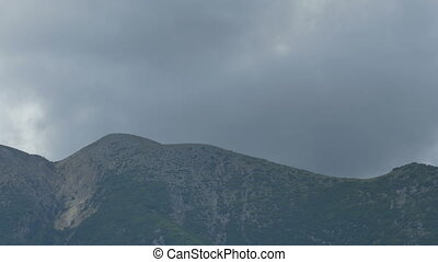 Clouds Passing Greek Mountains - Grey clouds passing the...