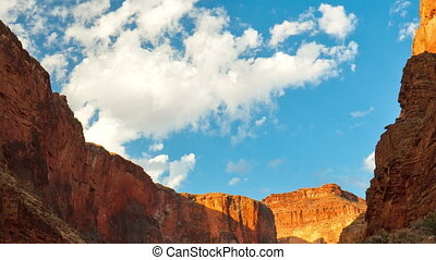 A time-lapse view of the clouds passing over the Grand Canyon in broad daylight.