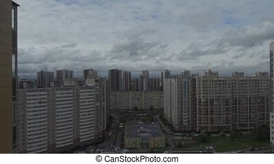 clouds quickly run over the multi-storey houses of the city.