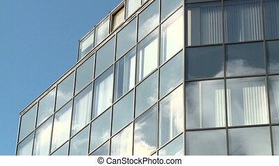 Clouds refelected in modern office building2
