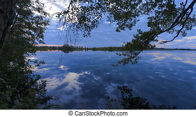 clouds reflected in the lake at sunrise.