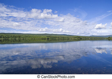 Clouds reflecting in lake Funasdalssjon