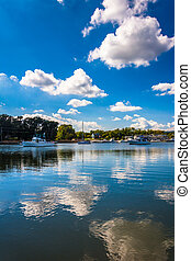Clouds reflecting in the water at the harbor in Chesapeake...