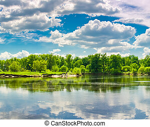 Clouds reflection on lake.