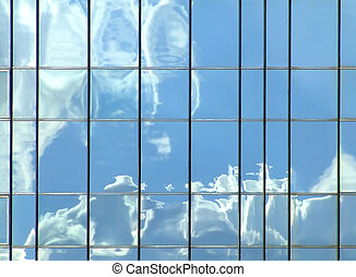 Clouds reflection in mirror building