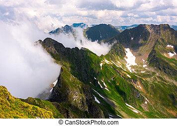 clouds rising in Fagaras mountains. beautiful summer scenery...