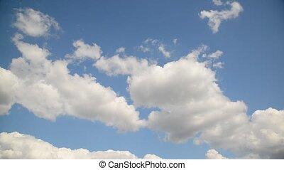 Clouds  slowly move across  sky